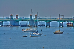 Sailboats anchored next to Brige of Lions in St. Augustine