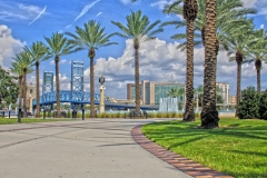 Palm trees and Main Street bridge with Friendship Park fountain