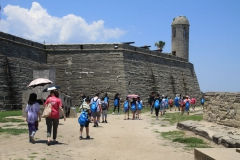 Group of exchange students walking around the Castille de San Marco in St. Augustine