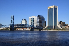 River flowing under Main Street Bridge and downtown Jacksonville skyline