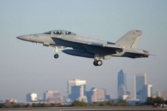 Navy F-18 Hornet taking off with Jacksonville Skyline behind
