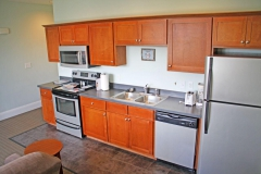Full kitchen with wood cabnitry and stainless steel appliances