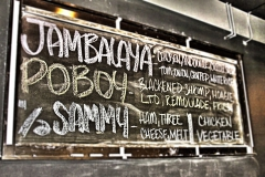 Chalkboard of daily special at Uptown Diner featuring Jambalaya and Poboy