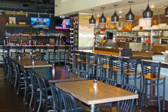 Interior of Uptown Diner with wine rack large flatscreen tv