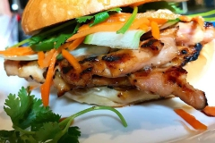 Grilled chicken sandwich with parsley and shaved carrots