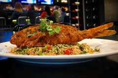 Deep fried whole snapper over bed of cajun rice